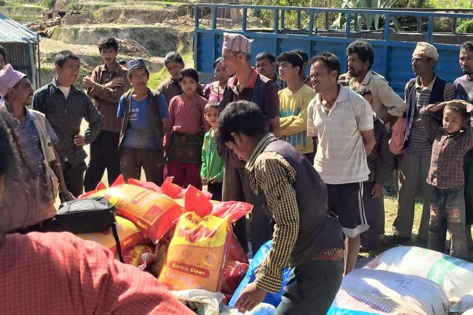Distributing food and clothes for earthquake victim